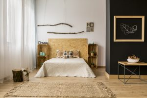Black and white bedroom with wooden DIY furniture and creative home decor